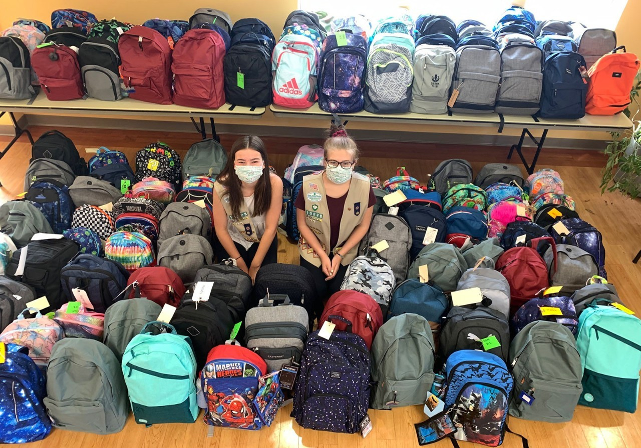 Choe and Colleen with backpacks